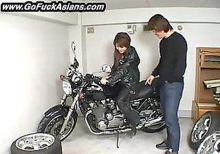 asian bikerchick receives her love tunnel tickled
